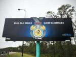 Run 26.2 Miles. Gain 9.6 Ounces. RunDisney billboard on Epcot Center Drive at the 2018 Disney World Marathon