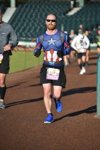 Josh Zeigler running the outside track of the ballpark, ESPN Wide World of Sports complex at the 2018 Disney World Marathon